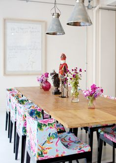 Dining room via @Rue Magazine. Love the vibrant floral pattern chairs with the simple white and neutral setting.