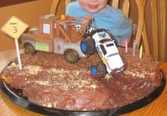 Mater towing a truck on top of chocolate cake or brownies?