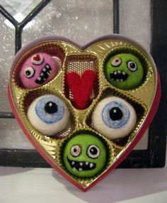 """Needle felted zombie """"candy"""".  Neat idea for repurposing candy boxes."""