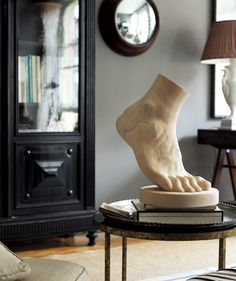 Add some whimsy (and a built-in conversation starter) to your living room with a quirky statue. Display it boldly, or tuck it away on a bookshelf.