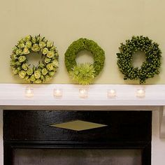 Three Wreaths | Groups of three decorative elements can help unify a space. Here, three smaller wreaths are hung above the mantel instead of one large one. | SouhernLiving.com