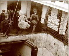 Mailbags brought aboard Titanic at Queenstown, Ireland, and elsewhere, were literally dropped to the mail storage compartment through the forward coal bunker hatchway. Courtesy of the Fr. Browne S.J. Collection, The Irish Picture Library