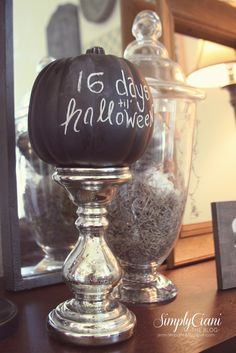Cool idea: Plastic pumpkins painted with chalkboard paint, write Halloween countdown on them and display on a candle stick ...love it :)