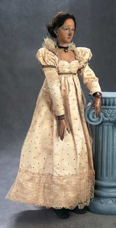 """View Catalog Item - Theriault's Antique Doll Auctions - 22"""" superb early french wooden poupee with fully articulated body and original gown"""