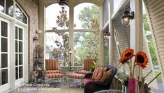 Floor to ceiling arched screen panels, hurricane shutters, and short knee wall finish this beautiful addition.