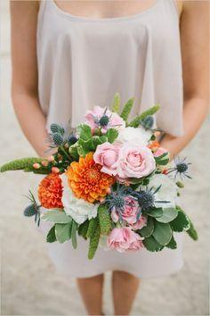 Mixed bridesmaids bouquet with light and bright hues. #bouquet #bridesmaids #weddingchicks Floral Design: My Little Flower Shop ---> http://www.weddingchicks.com/2014/05/05/southwestern-inspired-wedding/