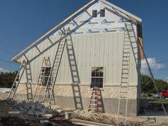 Hardie lap siding installed vertically with battens.  Texas Saltbox Garage - The Garage Journal Board