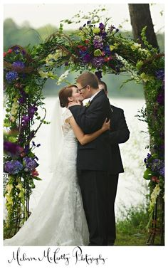 Southern Bride grapevine archway -  Snapdragons and grapevine in an arch for a southern wedding.  Add some white lights for evening wedding.