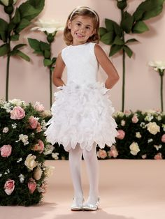 Sleeveless satin, lace and organza knee-length A-line dress, satin bodice features allover lace appliqué and back covered buttons, slight dropped waistline, skirt accented with large three-dimensional organza flowers and petals, ideal as a flower girl dress or party dress. Sizes: 2 – 14