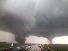 Stunning photo of dual tornadoes within a mile of each other on June 16th, 2014  Photo taken by stormchaser Matt Coker.   https://weatherpictureoftheday.files.wordpress.com/2014/06/coker_dual_tornadoes.jpeg