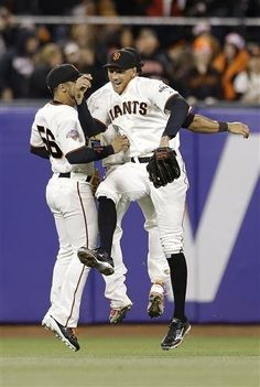 San Francisco Giants right fielder Hunter Pence, center, celebrates with center fielder Andres Torres (56) and center fielder Angel Pagan, hidden, after the final out of the ninth inning of a baseball game against the Colorado Rockies in San Francisco, Monday, April 8, 2013. The Giants won 4-2.