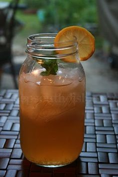 Southern Iced Tea Cocktail (1 oz light rum 1 oz vodka 1 oz gin 4 oz  freshly squeezed lemon juice or lemonade 3 oz unsweetened iced tea 1 to 2 oz simple syrup Sprigs of mint, for garnish Slices of lemon, for garnish)