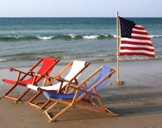 red, white and blue on the beach