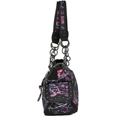 The Monte Vista Women's Muddy Girl Concealed Carry Handbag is made of 300-denier polyester and features a lined interior with dual compartments.