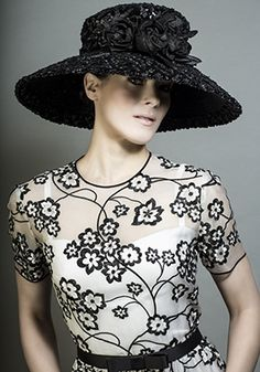 R13105 - Black swiss braid straw hat with silk flowers