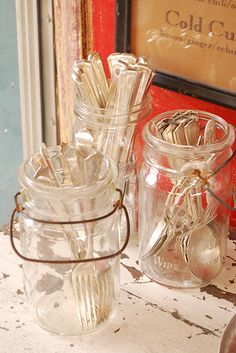 forks and spoons in mason jars