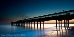 Boscombe Pier, Dorset, U.K. The planet in the top of the photo is Jupiter.
