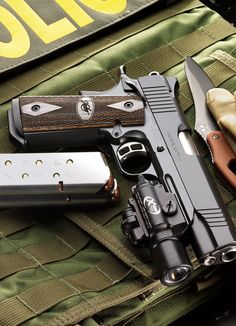 1911. Kimber baby!   Drop some pearls on it and call it done!