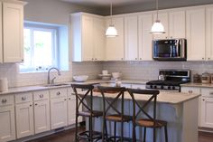White cabinetry, white subway tile and grey grout backsplash, river white granite...exactly what I want!!!