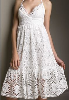 Crochet White Dress  It's so pretty, I just don't know where it comes from. I just saw it in a forum in Ravelry.