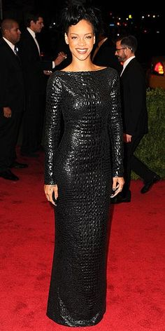 Rihanna in a textured black high-neck column dress, its absolutely stunning!