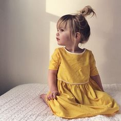 she is such a doll little dresses, little girls, messy buns, baby girls, little girl fashion, yellow dress, mustard yellow, kid hair, little girl hair