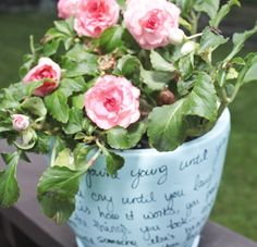 DIY Song Flower Pot...dollar store pot, spray paint, sharpie...and the lyrics of your favorite song!