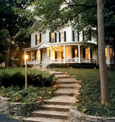 That porch... sigh. AND those steps with the little lights. One day..