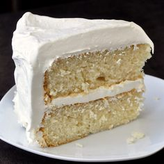 White Velvet Cake - so simple, moist and delicious, this close cousin to the red velvet cake is not only  a great dessert cake all on it's own but a great base to use to invent other cakes like adding a lemon curd filling or add coconut to the marshmallow frosting. Also a great cake to use for your favorite trifle recipes too.
