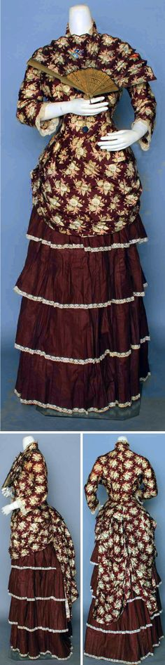 Print dress ca. 1880s. Two-piece dress of cotton sateen with blue floral print, lace trim, cut steel buttons, and matching fan. Augusta Auctions