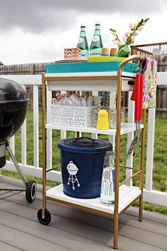 Re-purposed IKEA BYGEL Utility Cart used for an outdoor grilling buffet cart station. Bonus: it's very budget friendly! Oh...and the rest of Jen's deck & patio makeover is fabulous too! {IHeart Organizing: June Monthly Challenge: Outdoor Entertaining Cart!}