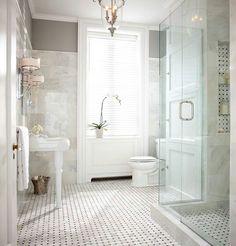 Window trim, marble walls, gray paint, frameless glass