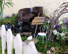 Picket Fence Fairy Garden - favorite part is the waterfall made with fish aquarium pump - also love the box she built it in, instructions from the ground up. lots of cute accessories she made, arch, sign, mailbox, chairs, bench, tables, planters, more.     ********************************************   ShabbyBeachNest - #fairy #garden #gardens #miniature #miniatures #crafts #DIY #whimsy #whimsical #waterfall - tå√