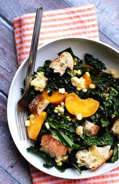 The fresh flavors of summer get to shine in this kale salad with peaches, corn, and basil-honey vinaigrette.