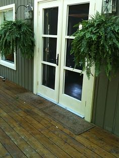 I LOVE the ferns hanging by the doors. I miss the ferns on our old front porch!