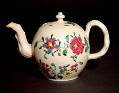 An English Saltglaze Pottery Miniature Polychrome decorated Teapot and cover.
