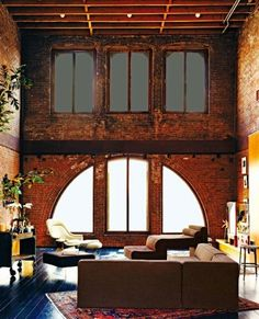 I would live to live in an old building with  exposed brick and interesting windows like this!