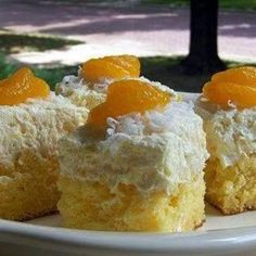Hawaiin Dream Cake. Pinapple, Orange, Cocunut-y flavors. Grandma used to make this all the time.