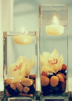 Lightful Wedding Centerpiece Idea with Candles With pink and white rocks at bottom, or pearls?