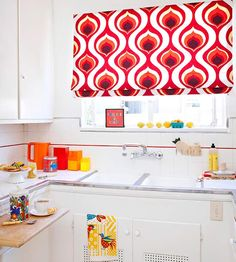 Love the pop of red in this white kitchen. #GoBold