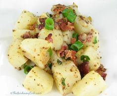 This Authentic German Potato Salad is just full of flavor. Serve it warm for a hearty side dish, or cold with a barbeque. Get the printable recipe http://thegardeningcook.com/authentic-german-potato-salad/