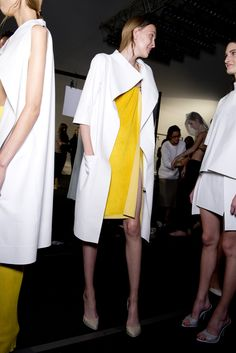 Sharp cuts, asymmetric silhouettes and a mix of ghost white and vivid hues at #LucasNascimento. #ss14 #lfw #topshopsupports