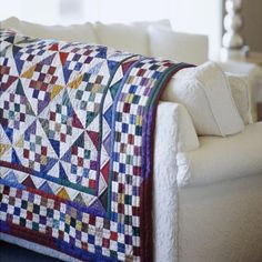 American Patchwork & Quilting, Mabeth Oxenreider's sixteen patch with a pinwheel block makes it look on point!