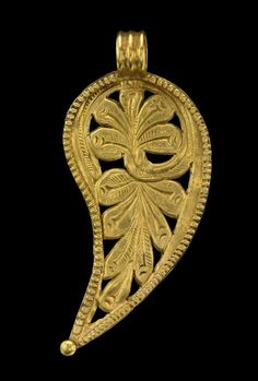 Gold leaf-shaped pendant in opus interrasile embossed and chased with a foliate design. The pendant is edged with square-toothed wire and a flattened granule is soldered to the tip; a suspension loop of triple-ribbed strip.       Early Byzantine - 7thC. Gold
