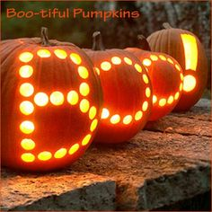Carving pumpkins by drilling out the holes with a drillbit!