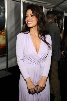 Sarah Shahi lovely cleavage in a low cut violet dress