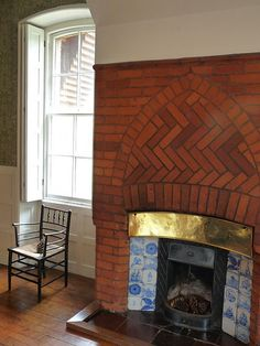 fireplace in the dining room at Red House