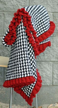 Wow!  Hounds tooth with a red ruffle--absolutely beautiful. Knitted Blanket--much easier than it looks because it uses a slip stitch technique.  Free pattern, just keep following the links.
