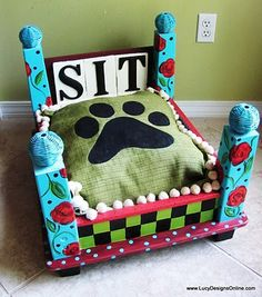 End table flipped upside down and painted with a cushion becomes a dog bed!   Love this!
