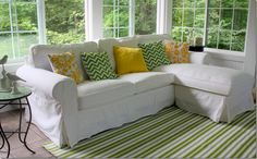 Love how chic the inexpensive Ikea sofa can look!  details here: http://hookedonhouses.net/2011/08/10/decorating-my-sunroom-finally-pulling-it-all-together/